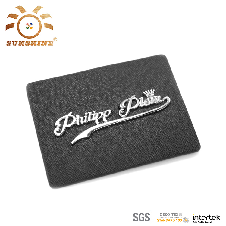 Leather label with metal logo