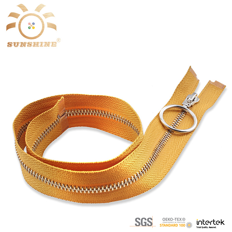Yellow metal zippers sell